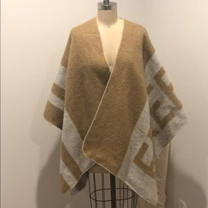 Zara poncho in size M, with text 'freezing' on it